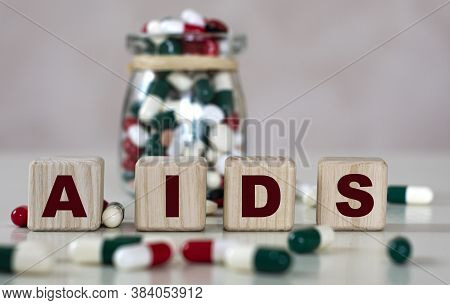 Abbreviation Aids (acquired Immunodeficiency Syndrome) - Text On Wooden Cubes On A Light Background