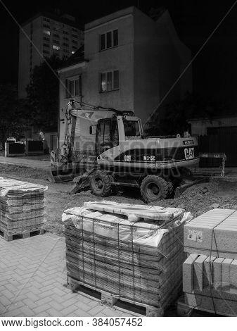 Chomutov, Czech Republic - August 11, 2020: Excavator In Husova Street During Reconstruction