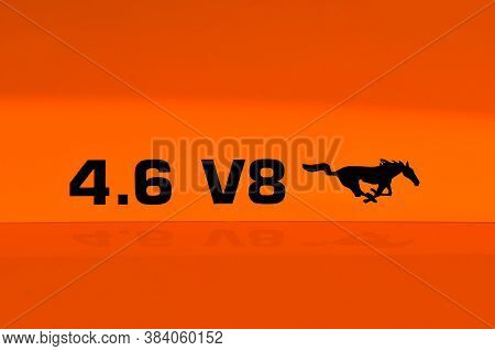 Bismarck, North Dakota, August 1, 2020: The  4.6, V*, And Running Mustang Logo Represents Ford Musta