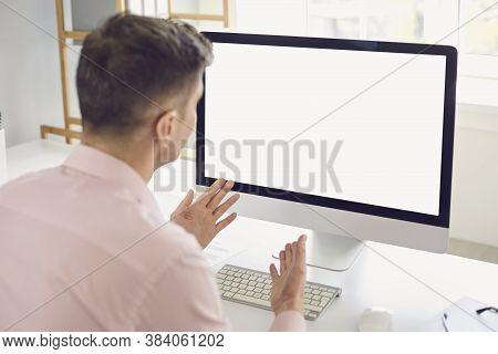 Man Using Personal Desktop Computer For Teleconference Communicating His Ideas During Video Call