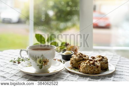 Traditional Homemade British Cheese Scones With Hot Cup Of Tea, Baked Scones English Buns With Brigh