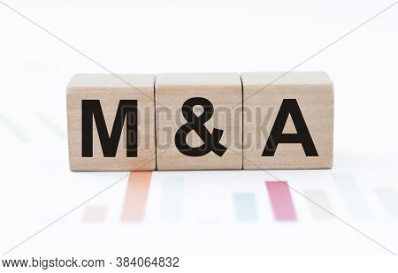 M And A Or Merger And Acquisition Text Written On A Wooden Cubes.