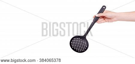 Hand With Black Plastic Ladle, Kitchen Utensil. Isolated On White Background, Copy Space Template, B