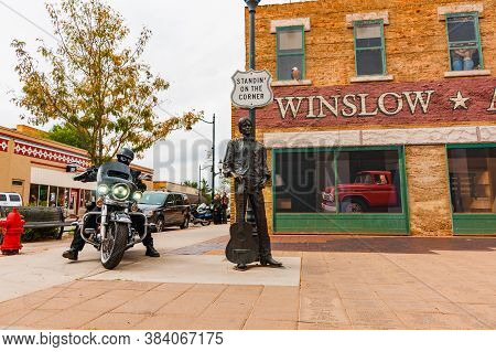 Winslow Arizona Usa - September 22 2015; Tourist Arrives On Harley Davidson Motorcycle At Famous  Wi