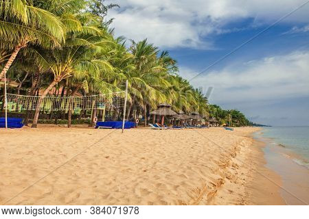Beautiful tropical beach with sea view, clean water & blue sky at Phu Quoc island in Vietnam