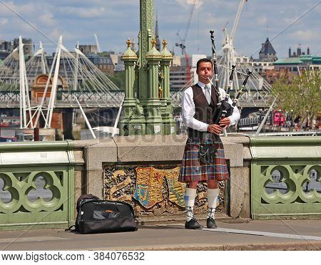 London, Great Britain -may 22, 2016: Scottish Piper On The Westminster Bridge In London