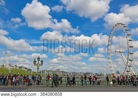 London, Great Britain -may 22, 2016: Pedestrians And Tourists On The Westminster Bridge