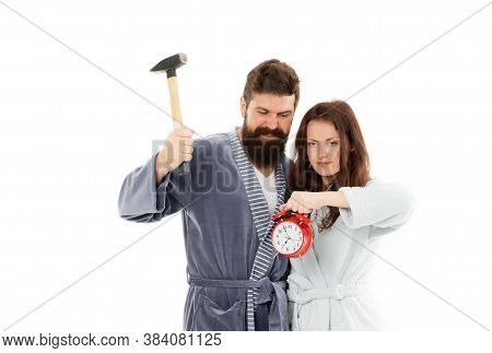 Early Morning Anxiety. Lets Get Rid Of This Annoying Alarm Clock. Couple In Bathrobes Going To Destr
