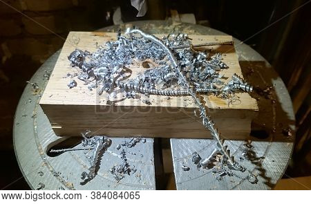 Metal Drill Bit Make Holes In Aluminum Billet On Industrial Drilling Machine With Shavings. Metal Wo