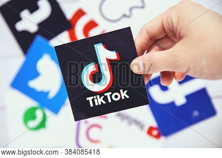 Wroclaw, Poland - August, 29th 2020: Hand Holds Tiktok Logo Over Another Social Media Symbols. Tikto