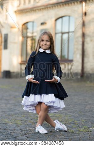 Plie Style Stance. Little Ballerina Wear School Uniform. Small Ballet Dancer Outdoors. Ballet School