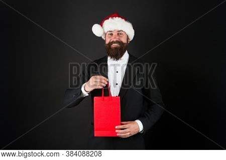 Santa Claus Is Here To Fill Everyones Wish. Happy Businessman With Santa Look. Bearded Man Hold Shop