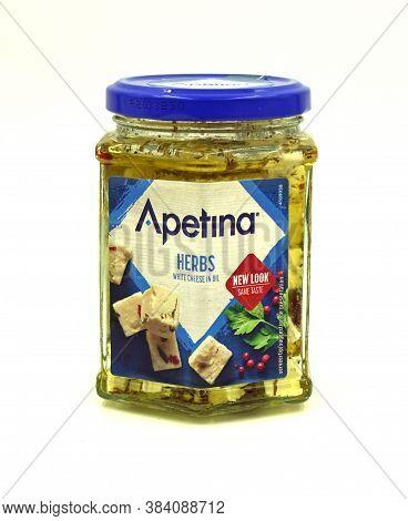 Zaandam, The Netherlands - September 6, 2020: Jar Of Apetina Herbs White Feta Cheese In Oil Against