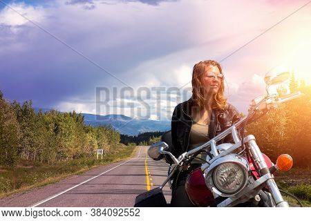 Female With Blonde Hair On A Motorcycle Composite. Background Of Scenic Road, Klondike Hwy Near Whit