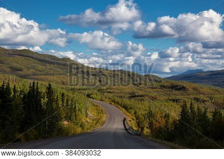 Scenic Road View Of Klondike Hwy During A Sunny And Cloudy Day. Taken Near Whitehorse, Yukon, Canada