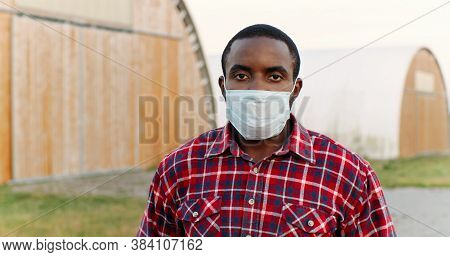 Close Up Of Young African American Sad Man In Motley Shirt Outdoors Looking At Camera. Portrait Of H