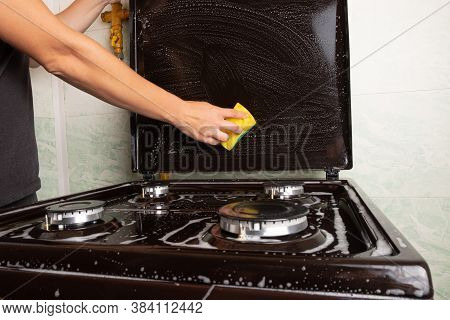 Cleaning The Kitchen, Surface Cleaning On The Gas Stove, Washing The Stove With A Yellow Washcloth,