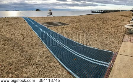NORWALK,CT, USA-SEPTEMBER 3, 2020: Empty Calf Pasture Beach early morning with large carpet on sand.