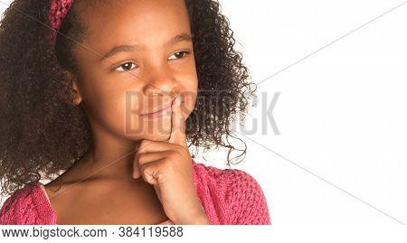 Child with finger on lips thinking emotion.