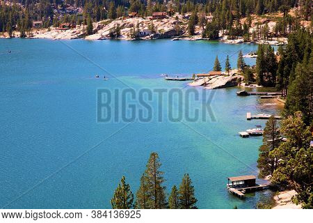 September 3, 2020 In Echo Lake, Ca:  Vacation Homes With Their Private Docks Surrounded By Pine Fore