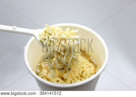 Instant Noodles, Noodle Soup In A Cup, View From Above. Instant Noodles Are Sold In A Precooked And