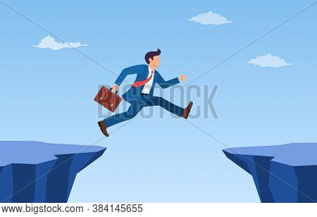 Businessman Jump Through The Gap In The Rocks. An Employee With A Running Jump From One Cliff To Ano