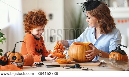 Happy Family A Cheerful Woman And Her Red-haired Son Are Laughing And Getting Ready For Halloween By
