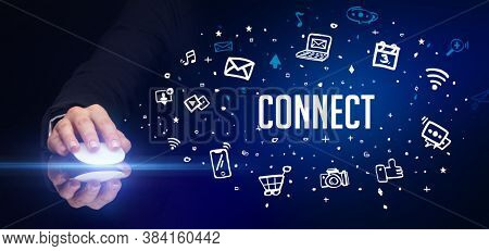 hand holding wireless peripheral with CONNECT inscription, social media concept