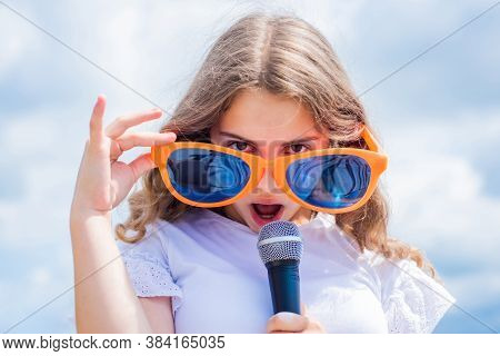 Everyone Deserves Good Music. Singer In Glasses With Microphone. Happy Childhood. Happy Girl Enjoy T