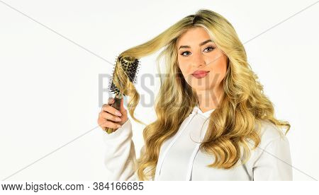 Professional Equipment. Pretty Woman Brushing Hair Isolated On White. Long Hair. Hair Care. Hairdres