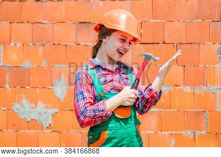 Childrens Creativity. Labor Day At 1 May. Little Girl In Hard Hat Holds Hammer. Best Repairer Ever.