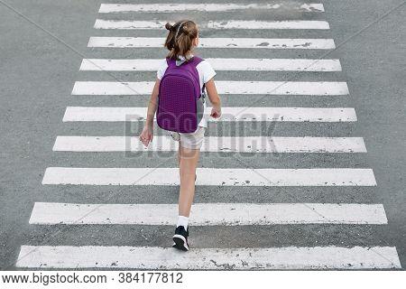 Schoolgirl Crossing Road On Way To School. Zebra Traffic Walk Way In The City. Concept Pedestrians P