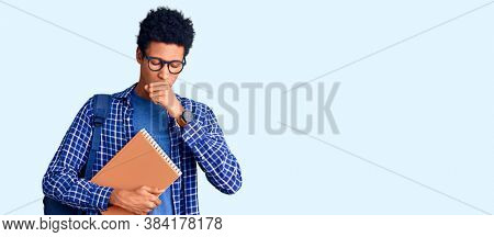 Young african american man wearing student backpack holding book feeling unwell and coughing as symptom for cold or bronchitis. health care concept.