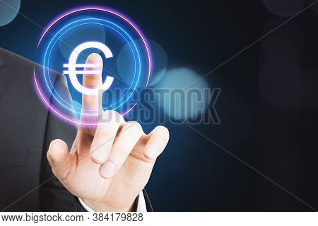 Businessman Presses A Euro Button In A Virtual Interface. Business And Financial Success Concept. Cl
