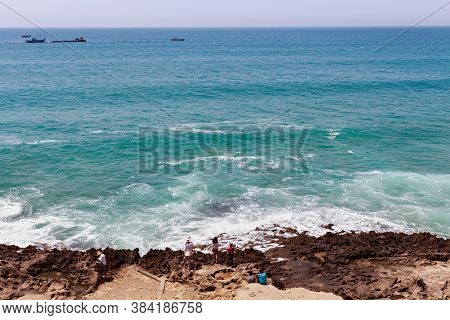 Tangier, Morocco - May 27, 2017: Unknown People On The Atlantic Ocean Coast In Sunny Day.