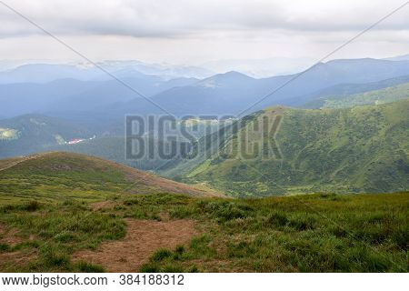 Landscape Of Mountains With Hills And Glades With Cloudy Sky. Carpathian Mountains