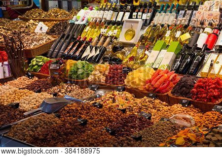 Barcelona, Spain - May 16, 2017: Sale Of Different Nuts, Dry Fruits, Oils And Other Products On The
