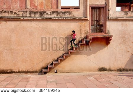 November 20th 2015 Fathepur Sikri Uttar Pradesh India: A Girl Child Walking Down From Stair With Her