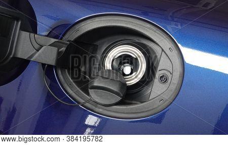 Open fuel tank door on car for fueling gasoline or diesel open