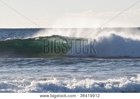 A Wave Crashing Towards Shoreline
