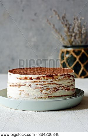 Crepe Cake Made Of Thin Crepe With Butter Cream, Cocoa, Chocolate,freeze-dried Strawberries. Delicio