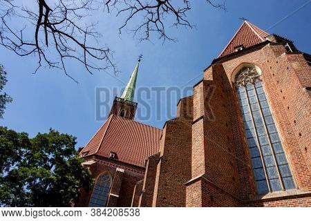 Towers Of Collegiate Church Of The Holy Cross And St. Bartholomew In Wroclaw, Poland, Eu