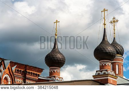 Russia, Yaroslavl, July 2020. Magnificent Domes Of A Brick Orthodox Church Against A Stormy Sky.