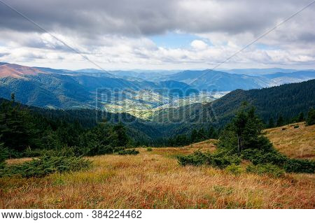 Mountain Landscape In Autumn. Beautiful View In To The Distance Valley From The Top Of A Hill. Cloud