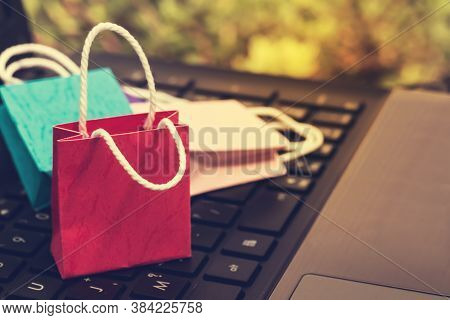 Business Concept Online Shopping, Paper Shopping Bags On Notebook Keyboard. Online Shopping E-commer