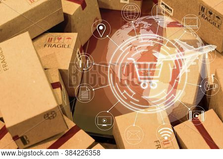 World Map With Mobile Phone On Pile Of Cardboard Boxes.  An Idea Of International Freight Or Shippin