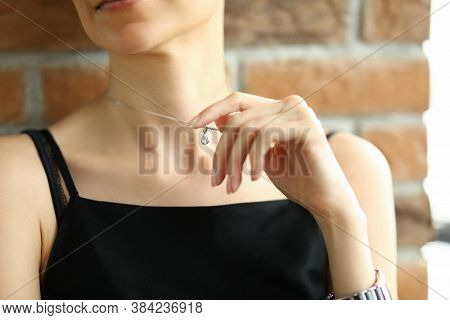 Portrait Of Female Wearing Luxury Accessory With Posh Diamond. Elegant Young Woman In Black Top. Bea