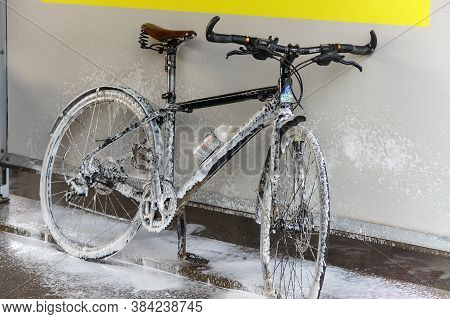 A Bicycle At A Car Wash, A Bicycle In Foam At A Car Wash, Washes His Bicycle, Russia, Kaliningrad Re