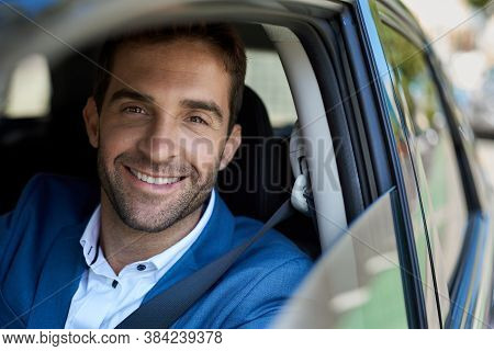 Smiling Man Sitting In His Car During His Morning Commute
