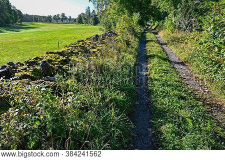 Gravel Road Beside Golf Course Near Kumla Sweden
